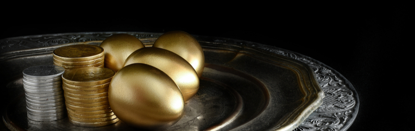 golden eggs and coins served on a silver tray